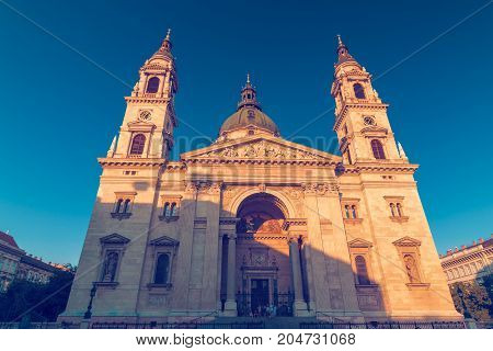 St. Stephen's Basilica roman catholic church building of Budapest in Hungary at sunset neo-classic style architecture wide shot
