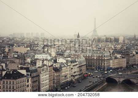 View of quai Saint-Michel and Paris in fog. France.
