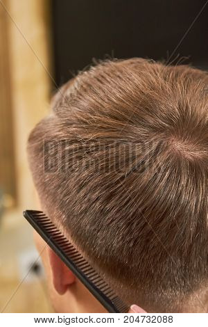 Male hair and comb. Head of man close up. Neat haircuts for men.