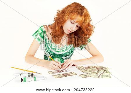 Woman earing a dress with a dollar print is painting bills. Forgery, money makes money