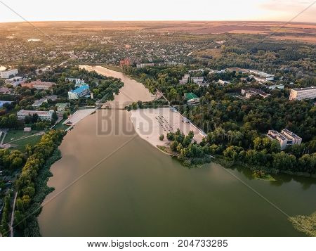 Aerial view on Mirgorod city from park side, Ukraine. Old photo style, sunset image