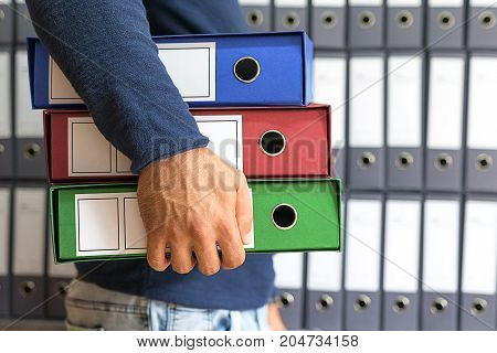 Man Holding, Corporate Files In Document Binder.