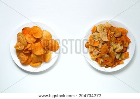 Golden Potato Chips. Whole And Beautiful Chips On One White Plate And Broken On A White Plate Next T