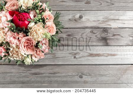 luxurious and elegant bouquet of roses and Other flowers. Composition colors on gray background. Copy space
