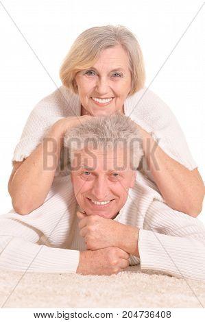 Portrait of senior couple posing isolated on white background