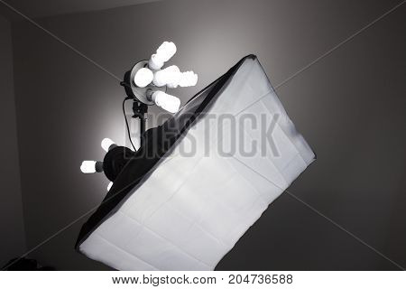 Photo of an empty photography studio equipment lighting. Empty space for your text or objects.