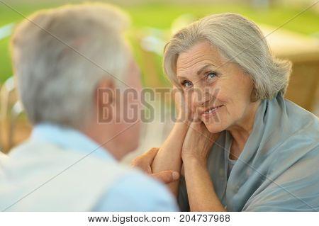 portrait of beautiful caucasian senior couple  talking in the park