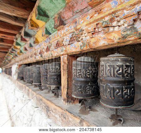 buddhist many prayer wheels buddhism in Nepal