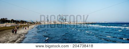 Larnaca, Cyprus, March 2017: Larnaca beach view with port and marina in a background Cyprus