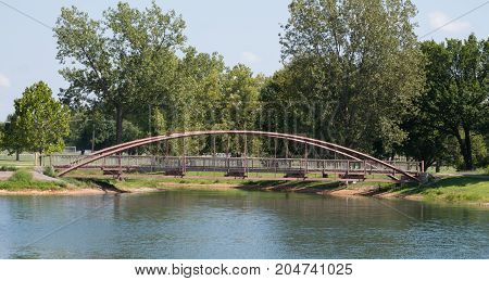 A scenic view of a bridge over a waterway in a Missouri park.