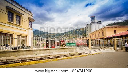 QUITO, ECUADOR AUGUST 20 2017: Outdoor view of Chinbacalle station, and railway at the train station of Chimbacalle Quito in Pichincha. It is the starting point of many luxury train journeys in the volcanic area.