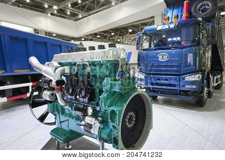 MOSCOW, SEP, 5, 2017: Close up view on Chinese FAW trucks exhibit on Commercial Transport Exhibition ComTrans-2017 FAW commercial transport on exhibition stand Commercial transport on exhibition stand