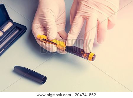 A man in medical gloves holds a syringe for subcutaneous injection of hormonal drugs in the IVF protocol in vitro fertilization , help to his wife.