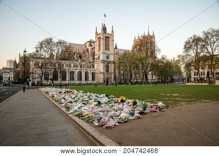 London, England, April 2017: Flowers in Parliament Square Garden after Terrorist attack on Westminster Bridge in March 2017 Central London