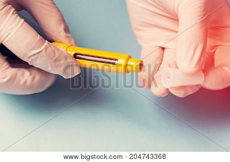 A Man In Medical Gloves Holds A Syringe For Subcutaneous Injection Of Hormonal Drugs In The Ivf Prot