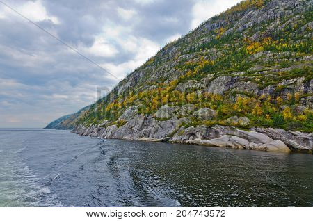 picture of the Saguenay river under dark clouds.