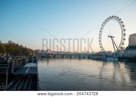 London, England, April 2017: View to London Eye and Thames river from Westminster Bridge early in the morning Great Britain