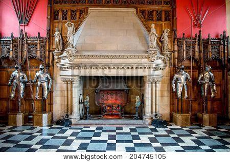 Edinburgh, Scotland, April 2017: A fireplace and knight armor inside of Great Hall in Edinburgh Castle Scotland