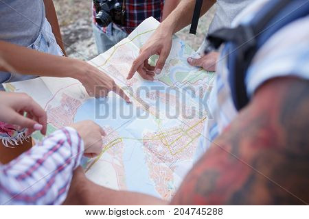 Group of Friends. Traveler Looking on the Map and Plan to Trekking and Adventure in the Forest - Travel in Holiday Summer Concept.