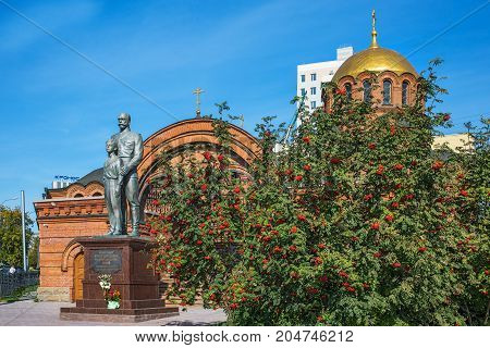 The city of Novosibirsk Siberia Russia - September 10 2017: the Monument to Emperor Nicholas II and Tsarevich Alexei at the Cathedral named after Alexander Nevsky