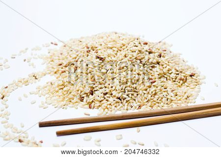 Yellow Rice And Wooden Chopsticks On White