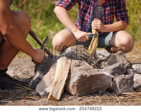 a man scribbles a tree to set fire to a fire. Summer vacations in the open air