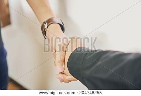 Businessmen are shaking hands after successful negotiations in business The concept of business advancement through collaboration.