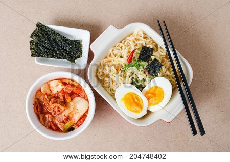 Korean food,Instant noodles seaweed and kimchi cabbage with chopsticks for eating