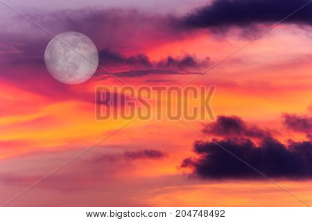 Moon clouds is a colorful surreal fantasy like pink and blue cloudscape with a magical surreal full moon rising in the night sky.