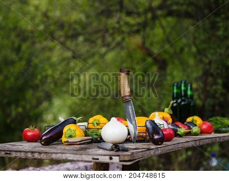 Fresh vegetables on a wooden table. Background. Healthy lifestyle