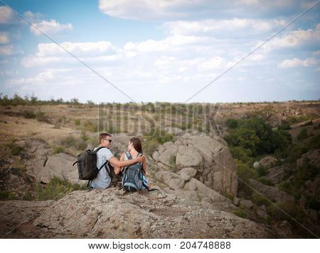 Two young travelers are resting on nature during the summer holidays
