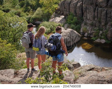 a group of tourists walking along the hills. healthy lifestyle