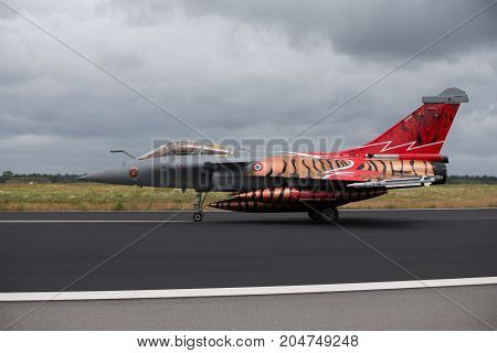 Schleswig - Jagel Germany - June 19 2014: French Air Force Dassault Rafale board number113-GU is taxiing during NATO Tiger Meet 2014. The plane has a special painter for MTM2014