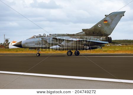 Schleswig - Jagel Germany - June 19 2014: Germany - Air Force Panavia Tornado board number 4624 is taxiing on strip of airbase Schleswig - Jagel during NATO Tiger Meet 2014.