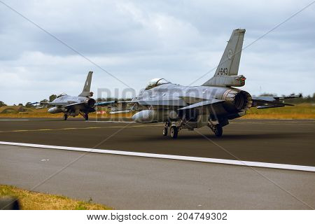 Schleswig - Jagel Germany - June 19 2014: Two Netherlands - Air Force General Dynamics F-16A Fighting Falcon is taxiing on strip of airbase Schleswig - Jagel during NATO Tiger Meet 2014.