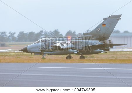 Schleswig - Jagel Germany - June 19 2014: Schleswig - Jagel Germany - June 19 2014: Germany - Air Force Panavia Tornado board number 4654 taxiing on runway after landing during Tiger Meet 2014