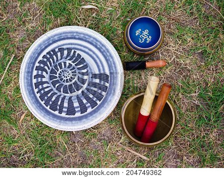 Image of tibetan bowls. Tools for energy. The sound of singing bowls. Yoga time.