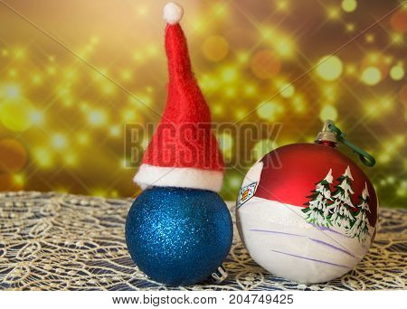 Christmas ball with caps, beautiful sparkling background, new year 2018.