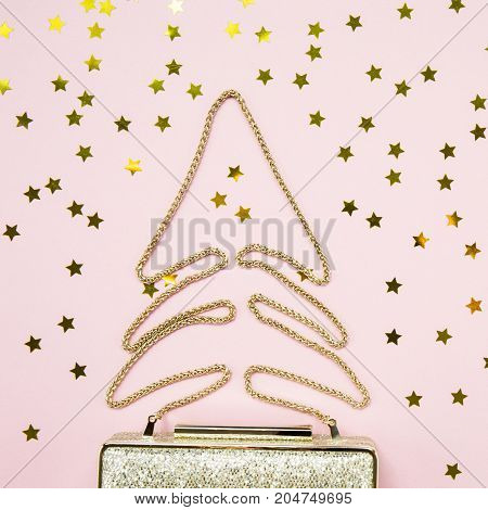 Festive Evening Golden Clutch With Star Sprinkles On Pink. Holiday And Celebration Background. Luxur