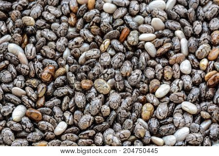 Close-up macro background of whole dried organic chia seeds