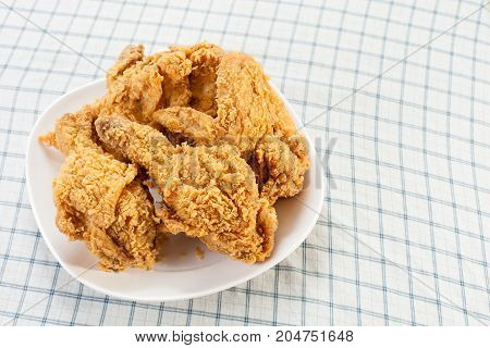 Fried chicken in dish on the table.