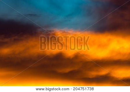 Background Texture Of Dramatic Sunset Sky With Orange Clouds After Thunderstorm