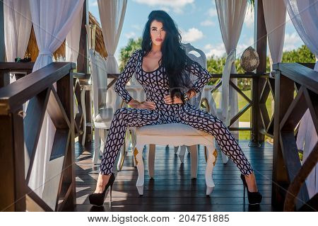 Sexy latina with long black hair in penthouse, park and restourant