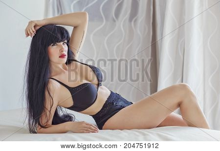 Sexy latina with long black hair in black lingerie