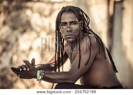 black man with dreadlocks, glasses, Topless, serious