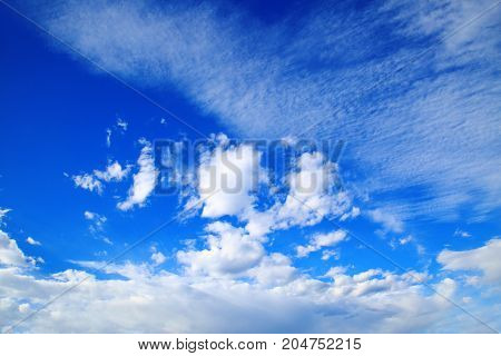 blue sky with beautiful white clouds .