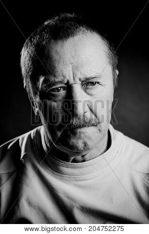portrait of an old men in black and white