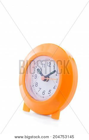 orange alarm clock isolated on white background.