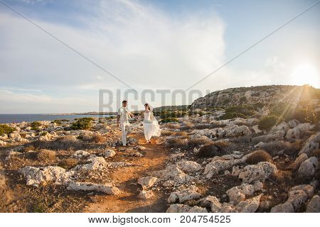 Bride and groom on their wedding day on nature