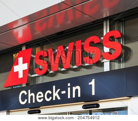 Kloten, Switzerland - 28 March, 2017: a sign of the Swiss International Air Lines company above an entrance to the check-in area of the Zurich Airport. The Swiss International Air Lines AG is the national airline of Switzerland.